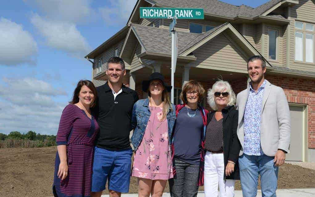 The Township of Woolwich dedicated an intersection in an Elmira subdivision to Richard Rank at a ceremony Aug. 31 in front of his family, friends and township contingency. Among those in attendance were Roxanne Rank, Kyle Rank, Caelen Rank, Mayor Sandy Shantz, Deby Rank and Garrett Rank. [Ali Wilson / The Observer]