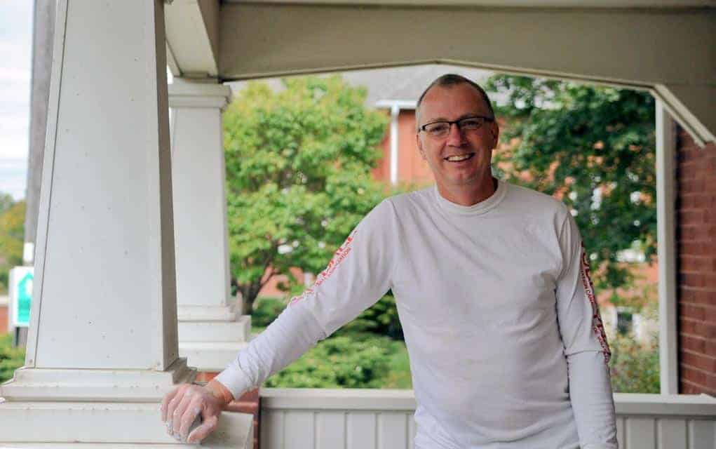 Dan Driedger, executive director of MennoHomes, is among those renovating the old home for its new tenants.
