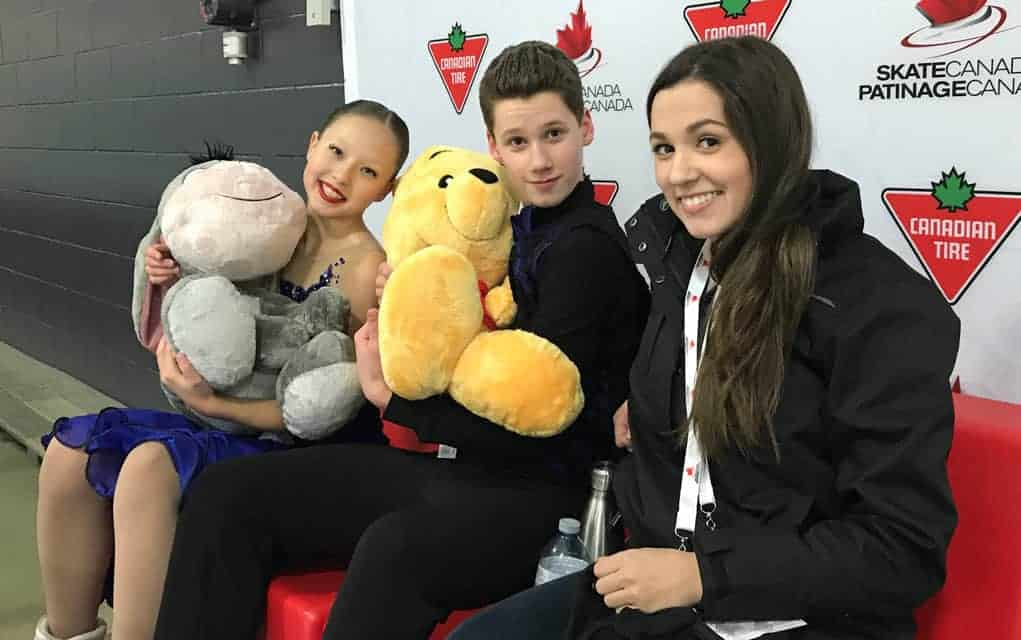 Sophia Kagolovskaya and Kieran MacDonald are joined by their coach Carleigh MacDonald at the competition last month that wrapped up the pair's pre-novice career.