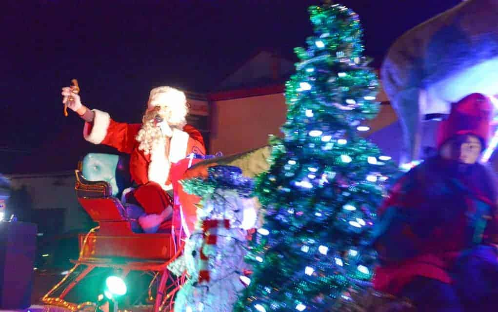 Santa Claus rode into Wellesley Friday evening for the annual Christmas Tyme parade, which features floats that light up the night. Photos by Ali Wilson / The Observer.