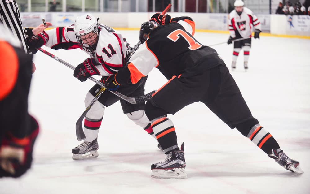 Applejack Brady Gerber battles it out during the faceoff at the Sunday afternoon home game against the Burford Bulldogs. Wellesley emerged as 7-2 winners.