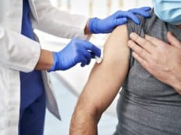 Close up of prepares a patient for vaccination